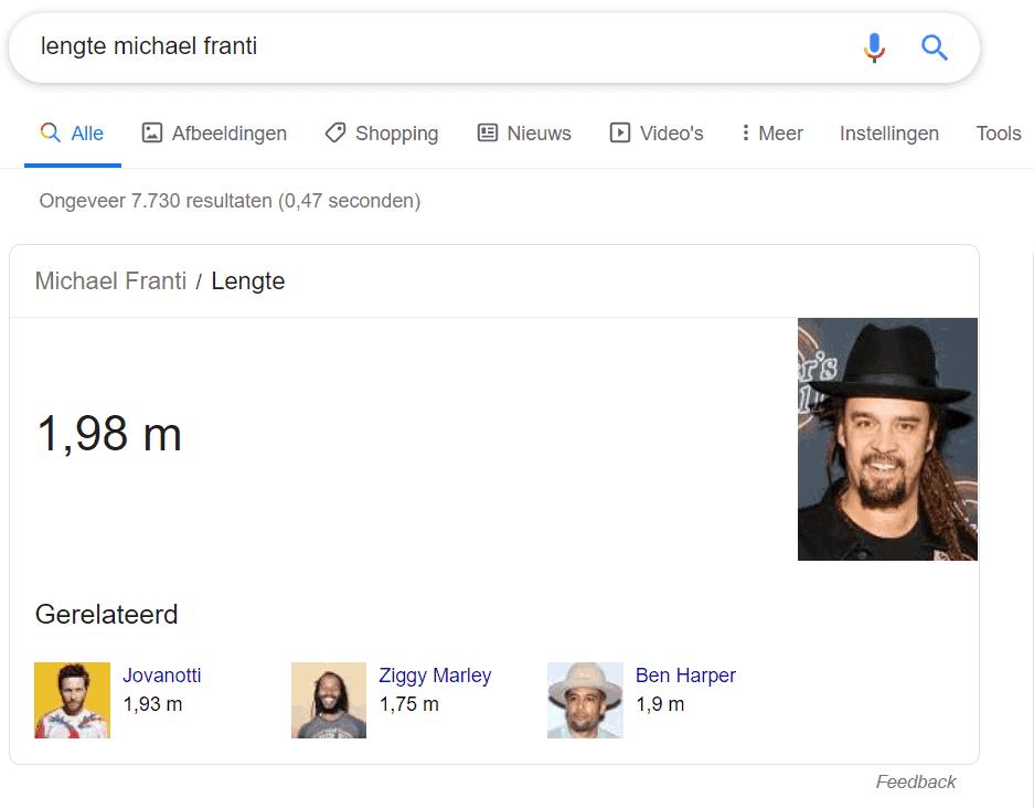 Google beantwoordt de vraag 'lengte Michael Franti' direct in de zoekresultaten: hij is 1.98 meter.