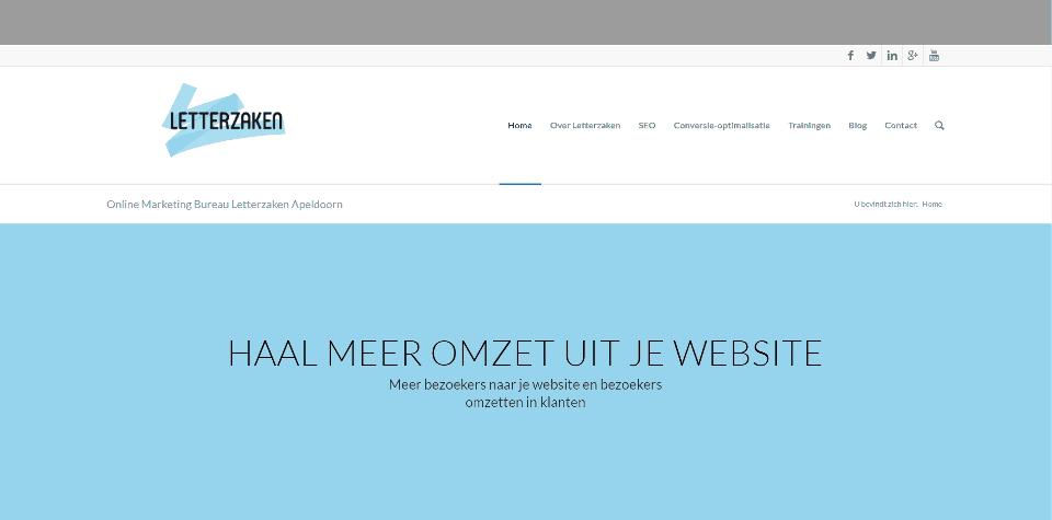 """De homepagina van letterzaken.nl in september 2016 met een grote blauwe balk met daarin de tagline 'Haal meer omzet uit je website""""."""